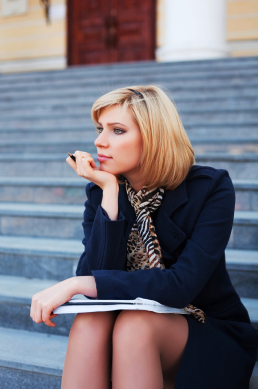 Young businesswoman with notebook.